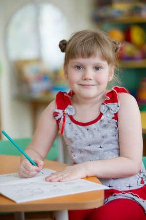 Preschooler with pencil and notebook Stock fotó