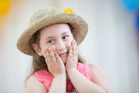 Beautiful preschool girl in a hat admires Stock fotó