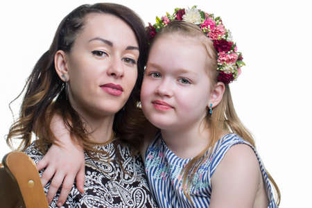 Portrait of a woman with a child. Mom with a teenage daughter on a white background. Фото со стока