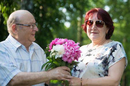 Happy elderly couple with flowers.Happy elderly couple with a bouquet of flowers.