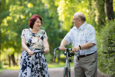 Happy elderly couple. Handsome man and woman senior citizens. Husband and wife of old age in the park.