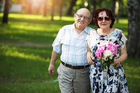 Happy elderly couple. Handsome man and woman senior citizens. Husband and wife of old age for a walk.