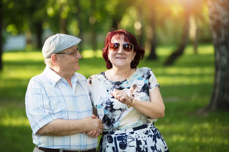 Portrait of a happy elderly couple. Handsome man and woman senior citizens. Husband and wife of old age for a walk.
