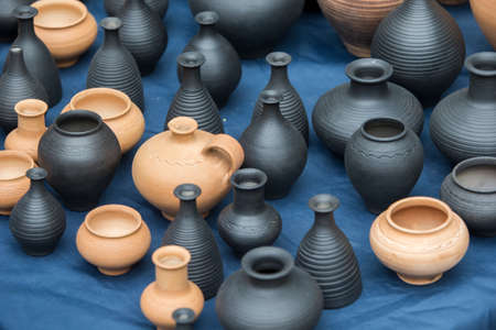 Clay vessels of different colors. Ceramics