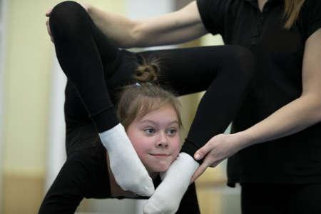 Indicative training circus school. Gymnastic workout. Girl with a flexible body Stok Fotoğraf