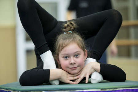 Indicative training circus school.Gymnastic workout. Girl with a flexible body