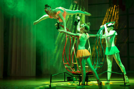 Belarus, Gomel, July 4, 2018. Indicative training circus school.Performance of circus acrobats on stage.Speech circus acrobats on stage. Three girls gymnasts perform number.Acrobatic Trick Performance