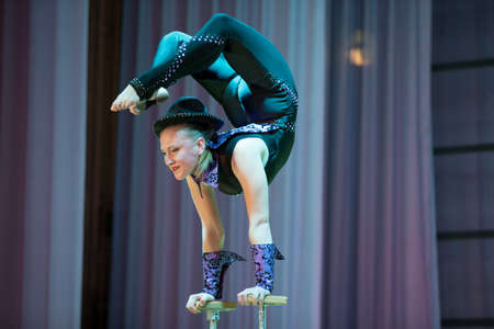 Indicative training circus school.Acrobatic performance of the actress.Girl with a flexible body.Balancing act