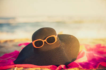 Sun hat glasses on a background of the sea. Vacation concept.