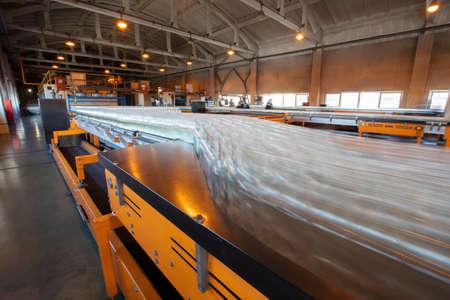 Blurry glass bottles on a conveyor belt.Glassworks. Glass industry.