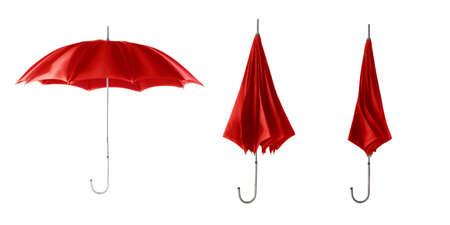 Three red retro umbrellas. Open umbrella step. 版權商用圖片