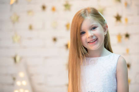 Portrait of a beautiful baby girl. The face of a five year old child. Small model