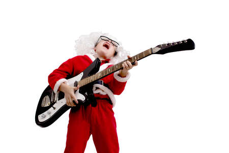 Boy dressed as Santa Claus with a guitar on a white background