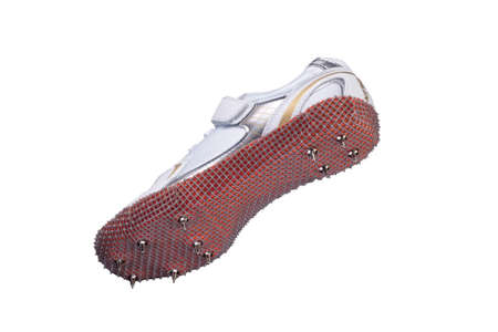 Sports shoes on a white background. White sneaker with spikes. Leather running shoes