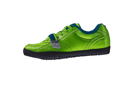 Green glossy sneaker on a white background. Sport shoes Stock Photo