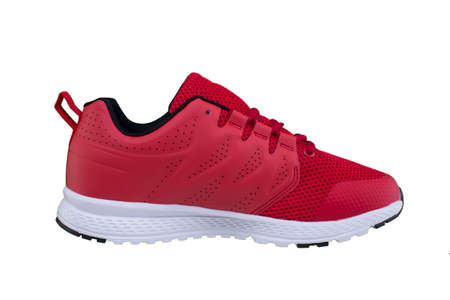 Red sneaker against white background. Sport shoes