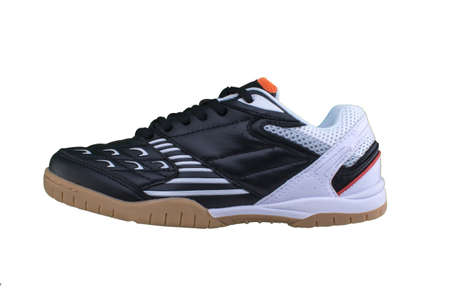 Black sneakers with color inserts on a white sole. Sport shoes on a white background.