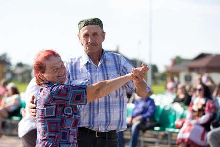 August 29, 2020 Belarus, the village of Lyaskovichi. Dance floor. An elderly couple is dancing.
