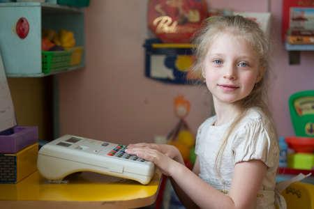 May 30, 2019 Belarus, Gomil. Kindergarten open day.Preschool girl playing in kindergarten. Sajtókép