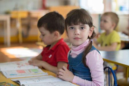 May 30, 2019 Belarus, Gomil. Kindergarten open day.Preschoolers at school desks in kindergarten.