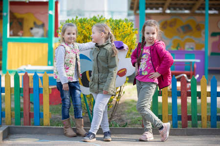 May 30, 2019 Belarus, Gomil. Kindergarten open day.Three elementary girls are playing outside. Sajtókép