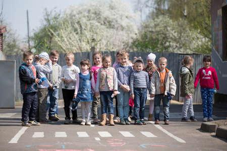 May 30, 2019 Belarus, Gomil. Kindergarten open day.A group of Russian preschool children in a kindergarten on the street.