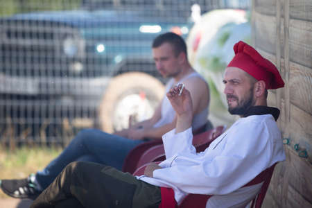 August 29, 2020. Belarus. The village of Lyaskovichi. Celebration in the city. The cook got tired and sat down to smoke. Sajtókép