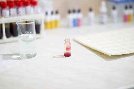 Blood test.Medical jar with blood