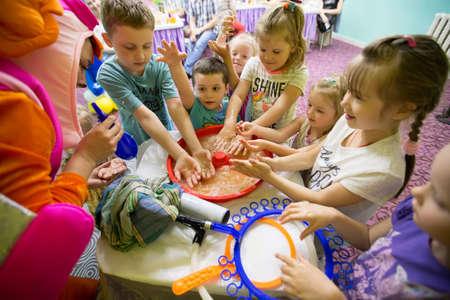 Belarus, Gomel, 189 May 2018. Children's entertainment center store. Celebrating the birthday of children.Children on the show of soap bubbles Sajtókép