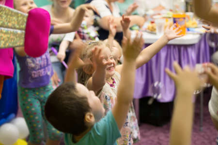 Belarus, Gomel, 189 May 2018. Children's entertainment center store. Celebrating the birthday of children.Happy beautiful children, smartly catching soap bubbles, laughing.Children's party. Fun party.Soap bubbles show.