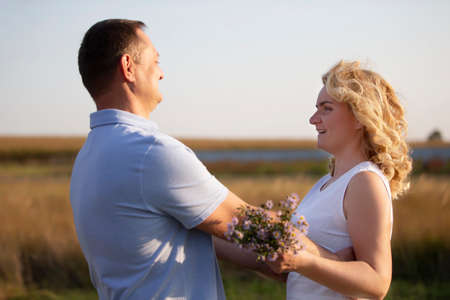 Beautiful middle-aged couple in love on the background of nature. Husband and wife. Stock fotó