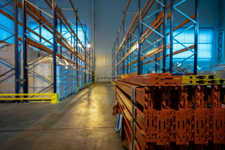 Warehouse premises of a factory or workshop with metal shelves.