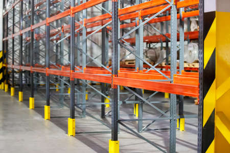 Metal structure of warehouse shelves for storing products. Foto de archivo
