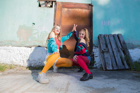 Funny girls in the style of the 90s in bright clothes.