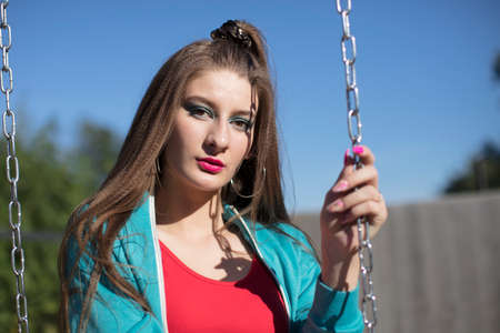 Cool teenager. Fashionable girl in bright sportswear in retro style in the atmosphere of the 80s-90s. Standard-Bild