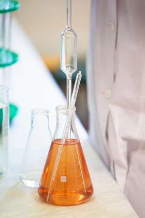 Laboratory with glass test tubes for alcoholic beverages. Standard-Bild