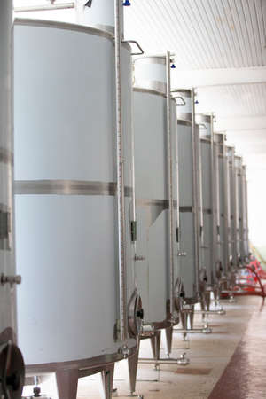 Industrial metal tanks for wine at a plant for the production of alcoholic beverages.