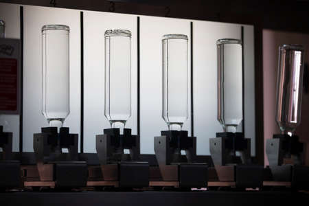 Glass products. Beverage bottles. Technological work at the plant. Standard-Bild