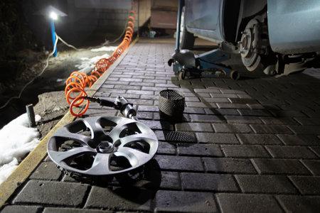 Car wheel repair in a tire workshop.