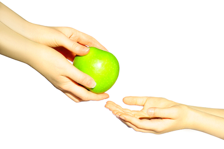 sens: Mom gives an apple to the child. It sens an apple from hand to hand. Share apple Stock Photo