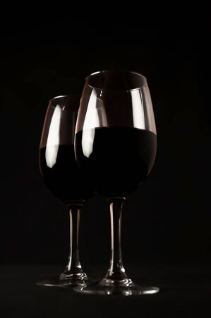 Red Wine. Two Glasses of Red Wine on Black Background