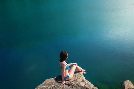 Beautiful Young Woman in Swimsuit Standing on the Lake In the Morning. Concept Tourism. Summer Background