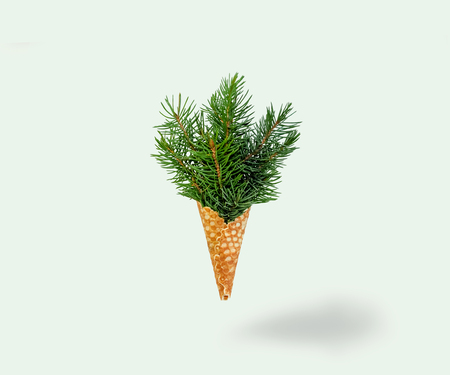 Christmas Tree Ice Cream Levitation on Ligth Background. New Year Concept. Minimal Holiday Composition. Copy Space