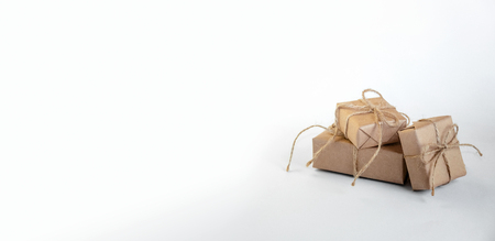 Christmas Gifts on Light Background. Minimal New Year Holiday Composition. Copy Space For Your Text