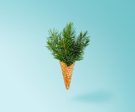 Christmas Tree Ice Cream Levitation on Ligth Blue Background. New Year Concept. Minimal Holiday Composition. Copy Space 写真素材