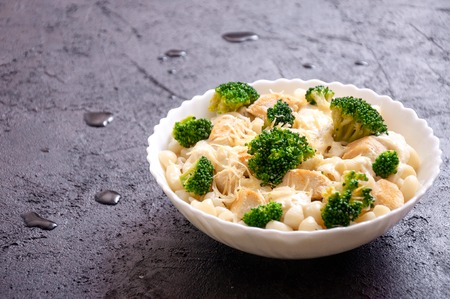 Elbow Macaroni with Chicken, Broccoli, Cheese and Cream Sauce on Dark Background 写真素材