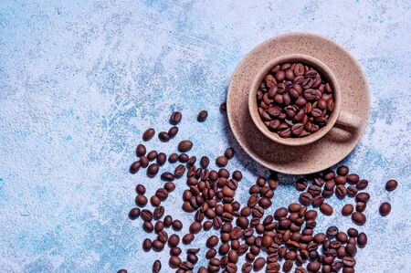 Cup of Aromatic Coffee with Grains on Light Blue Background. Top View Flat Lay. Copy Space For Your Text Archivio Fotografico - 133517304