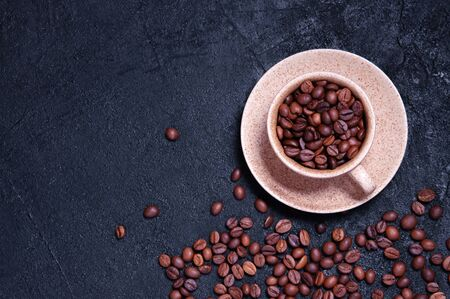 Cup of Aromatic Coffee with Grains on Dark Background. Top View Flat Lay. Copy Space For Your Text Archivio Fotografico - 133517306