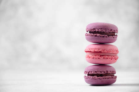 French Pink and Purple Macaroons on Light Grey Background Banque d'images