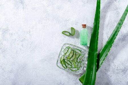 Aloe Vera Slices, Leaves and Jar with juice Aloe Vera. Cosmetics and Herbal Medicine Concept. Top View Flat Lay. Copy Space